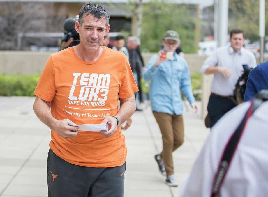 Texas men's tennis coach Michael Center walks with Defense lawyer Dan Cogdell away from the United States Federal Courthouse in  Austin, Texas, Tuesday, March 12, 2019.  Michael Center was placed on administrative leave after being charged by federal authorities that he allegedly accepted a $100,000 bribe in 2015 to help a student's admission. RICARDO B. BRAZZIELL/AMERICAN-STATESMAN] Photo: RICARDO B. BRAZZIELL / AMERICAN-/Ricardo B. Brazziell / AUSTIN AMERICAN-STATESMAN