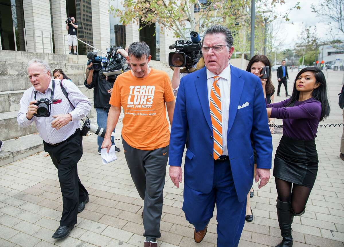 Texas men's tennis coach Michael Center walks with Defense lawyer Dan Cogdell away from the United States Federal Courthouse in Austin, Texas, Tuesday, March 12, 2019. Michael Center was placed on administrative leave after being charged by federal authorities that he allegedly accepted a $100,000 bribe in 2015 to help a student's admission. RICARDO B. BRAZZIELL/AMERICAN-STATESMAN]