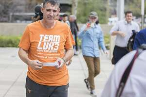 Texas men's tennis coach Michael Center walks with defense lawyer Dan Cogdell away from the U.S. Federal Courthouse in Austin, Texas, Tuesday, March 12, 2019. Michael Center was placed on administrative leave after being charged by federal authorities that he accepted a $100,000 bribe in 2015 to help a student's admission process.