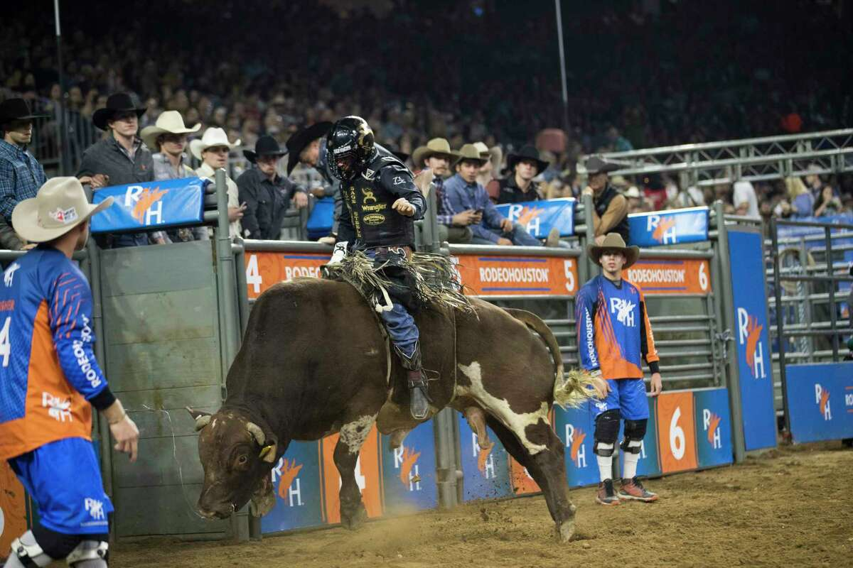 Sage Steele Kimzey competes in the Super Series 5 Round 3 bull riding category at the Rodeo Houston on Tuesday, March 12, 2019, in Houston.