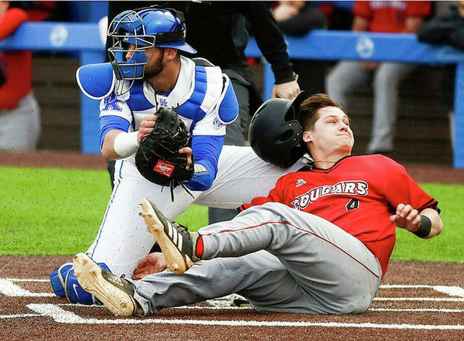 Garrett Carmichael of SIUE (4) is tagged out at home plate by Kentucky catcher Coltyn Kessler during college baseball action Tuesday in Lexington, Ky. The Wildcats rallied to beat SIUE 6-4. Photo: Kentucky Athletics