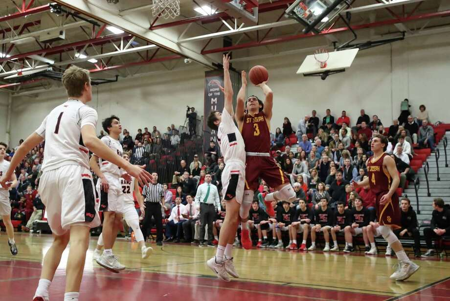 Stephen Paolini (3) of St. Joeseph's goes up for a basket during the Division IV Semi Final game between St. Joseph High School Boys Varsity Basketball and New Canaan Boys Varsity Basketball on March 12, 2019 at Warde - Fairfield High School in Fairfield, CT. Photo: John McCreary / For Hearst Connecticut Media / Connecticut Post Freelance