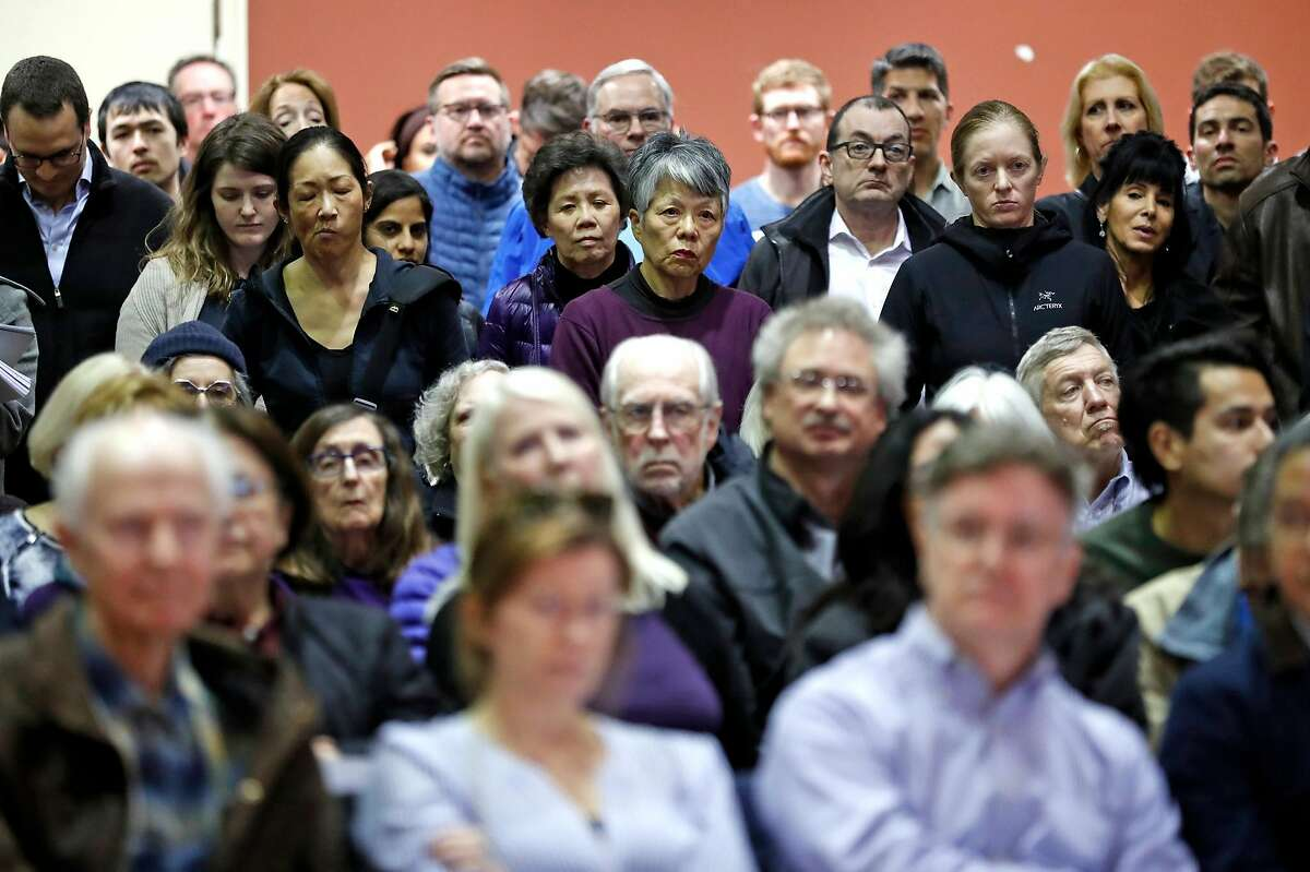 Crowd members listen to comments during Embarcadero SAFE Navigation Center informational meeting at Delancey Street Foundation in San Francisco, Calif., on Tuesday, March 12, 2019.