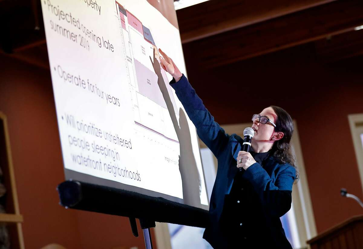 Emily Cohen, Homelessness Policy Advisor , points out the proposed site during Embarcadero SAFE Navigation Center informational meeting at Delancey Street Foundation in San Francisco, Calif., on Tuesday, March 12, 2019.