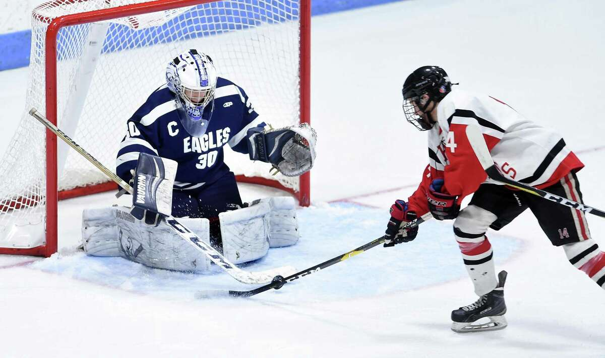 WMRP goalie defends against Samuel Roberts of Branford in the CIAC Division II semifinal at Ingalls Rink in New Haven on Tuesday.
