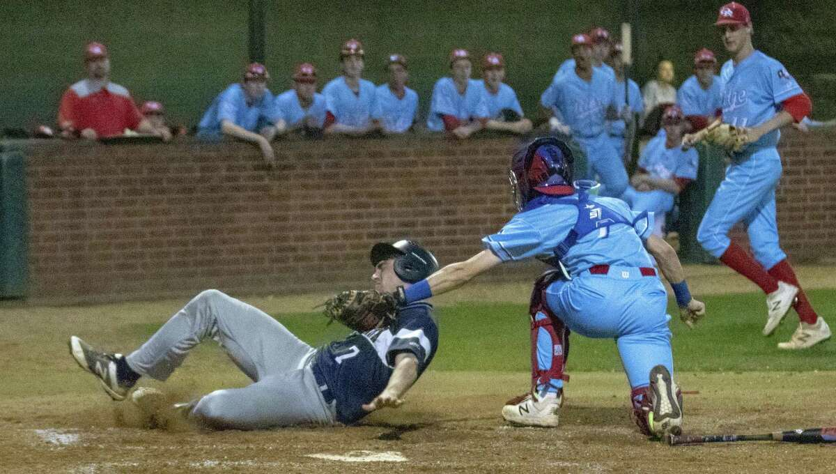 Oak Ridge catcher Bryce Lewis (7) tags out College Park relief runner Casen Holden (7) at home plate during a District 15-6A baseball game at Oak Ridge High School.