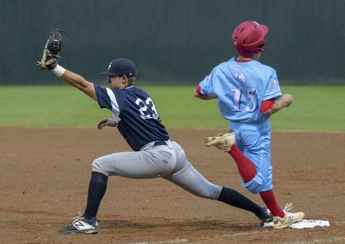 College Park first baseman Kyle Mann (23) secures an out against Oak Ridge short stop Carson Ogilvie (15) during a District 15-6A baseball game at Oak Ridge High School.