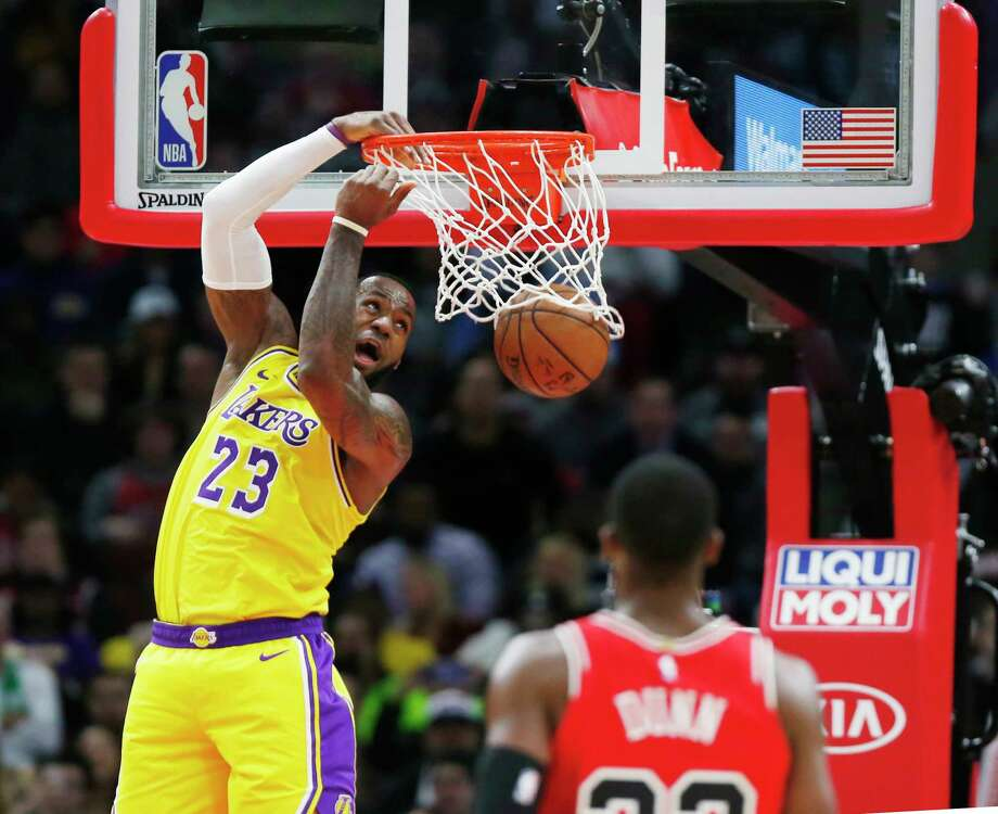 Los Angeles Lakers forward LeBron James (23) dunks in front of Chicago Bulls guard Kris Dunn during the second half of an NBA basketball game Tuesday, March 12, 2019, in Chicago. (AP Photo/Nuccio DiNuzzo) Photo: Nuccio DiNuzzo / Copyright 2019 The Associated Press. All rights reserved.