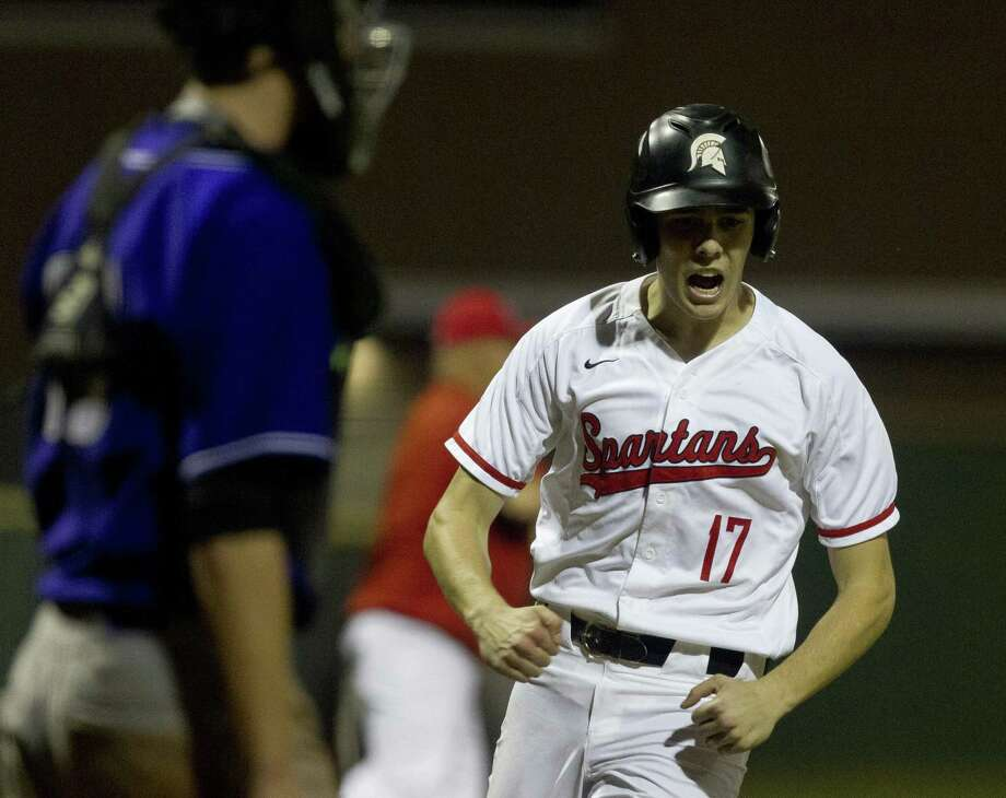 Zane Russell #17 of Porter reacts after scoring on Jace Russell's single to tie the game 4-4 during the fifth inning of a District 20-5A high school baseball game at Porter High School, Tuesday, March 12, 2019, in Porter. Photo: Jason Fochtman, Houston Chronicle / Staff Photographer / © 2019 Houston Chronicle