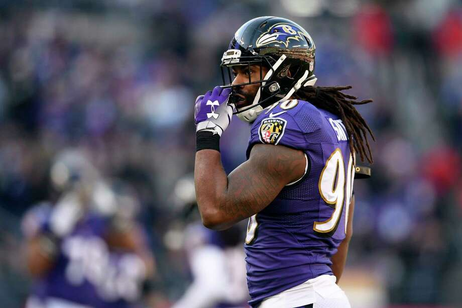 FILE - In this Jan. 6, 2019, file photo, Baltimore Ravens outside linebacker Za'Darius Smith walks on the field during the second half of an NFL wild card playoff football game against the Los Angeles Chargers in Baltimore. With unrestricted free agent linebackers C.J. Mosley, Terrell Suggs and Za?Darius Smith headed elsewhere after the release last week of safety Eric Weddle, the Ravens lost four key contributors while adding much-needed salary cap space. (AP Photo/Nick Wass, File) Photo: Nick Wass / Copyright 2019 The Associated Press. All rights reserved.