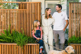 Tie It All Together Raul, Birgit, Milla (far left), and their dog Charlie outside their Noe Valley home. Raul and two friends built the fence and containers to mimic the pathway and structure in the backyard. Asparagus ferns and sedum spill out from the raised beds, while bamboo pokes up from behind the fence.