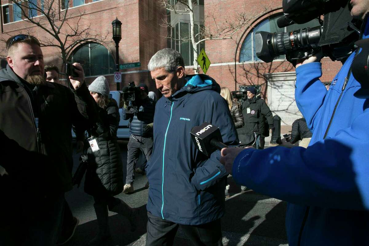 William Rick Singer leaves the federal courthouse in Boston after pleading guilty to charges related to college admission schemes, March 12, 2019. Singer allegedly fabricated athletic ?profiles? of students to submit with their college applications, which contained teams the students had not played on and fake honors not won. (Katherine Taylor/The New York Times)