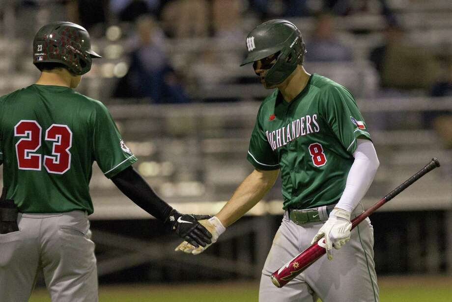 In this file photo, Luke Hammond (8) of The Woodlands gets a high-five during the third inning of a District 15-6A high school baseball game at College Park High School, Thursday, March 7, 2019, in The Woodlands. Photo: Jason Fochtman, Houston Chronicle / Staff Photographer / © 2019 Houston Chronicle