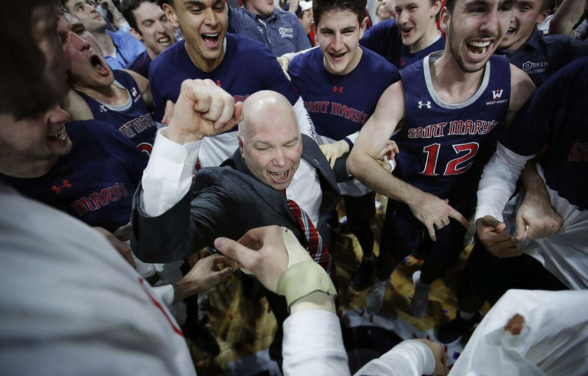 St. Mary's head coach Randy Bennett celebrates after his team defeated Gonzaga 60-47 in an NCAA college basketball game for the West Coast Conference men's tournament title, Tuesday, March 12, 2019, in Las Vegas. (AP Photo/John Locher)