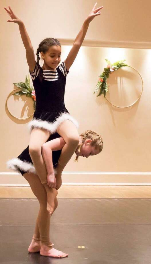 """Students from Studio D in New Milford recently participated in the studio's """"Winter Showcase Gala"""" and performed at Stamford's Palace Theater. Above, Brianna Gray, top, and Macie Rubini perform at the showcase gala in New Milford. Photo: Courtesy Of Studio D / The News-Times Contributed"""