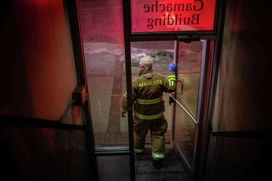 Firefighter Steve Goupil leaves a building after responding to a call on Feb. 8. In 2017, the state had a synthetic-opioid-overdose death rate of approximately 28 per 100,000 people, with Maryland, Massachusetts and Washington, D.C., not far behind. Only West Virginia and Ohio had higher rates. Photo: Washington Post Photo By Salwan Georges. / The Washington Post