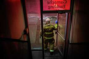Manchester, New Hampshire, firefighter Steve Goupil leaves a building after responding to a call on Feb. 8. In 2017, the state had a synthetic-opioid-overdose death rate of approximately 28 per 100,000 people, with Maryland, Massachusetts and Washington, D.C., not far behind. Only West Virginia and Ohio had higher rates.