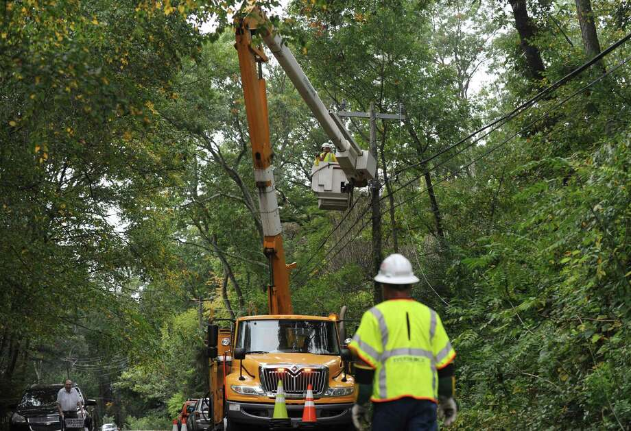 Workers with Eversource power company repair the electrical lines on Quarry Road Tuesday, October 9, 2018, after a tree limb came down on wires leaving resients in the area withour power in Norwalk, Conn. Photo: Erik Trautmann / Hearst Connecticut Media / Norwalk Hour