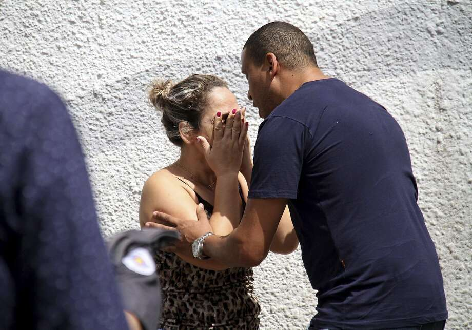 A man comforts a woman at the Raul Brasil State School in Suzano, Brazil, Wednesday, March 13, 2019. The state government of Sao Paulo said two teenagers, armed with guns and wearing hoods, entered the school and began shooting at students. They then killed themselves, according to the statement. (Mauricio Sumiya/Futura Press via AP) Photo: Mauricio Sumiya, Associated Press