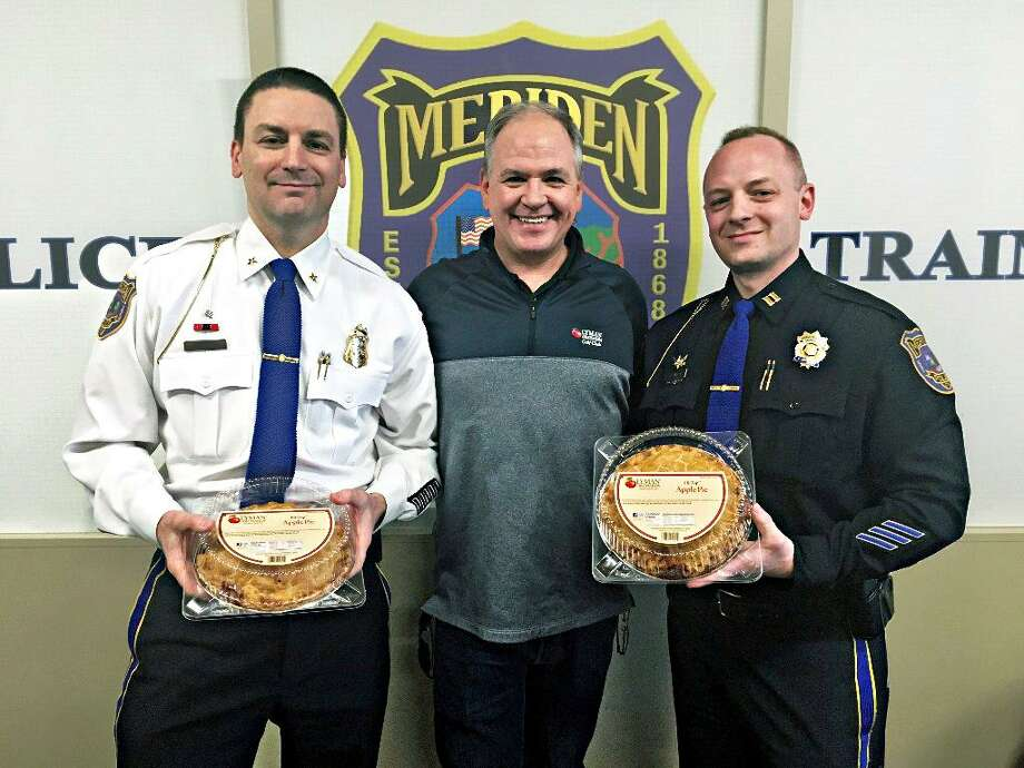 From left, Meriden Deputy Chief of Police Mark Walerysiak, Tim Burt, director of Marketing & Retail Operations at Lyman Orchards; and Capt. Nick Sherwood show off pies donated by Lyman of Middlefield to the department for Pi Day. Photo: Contributed Photo