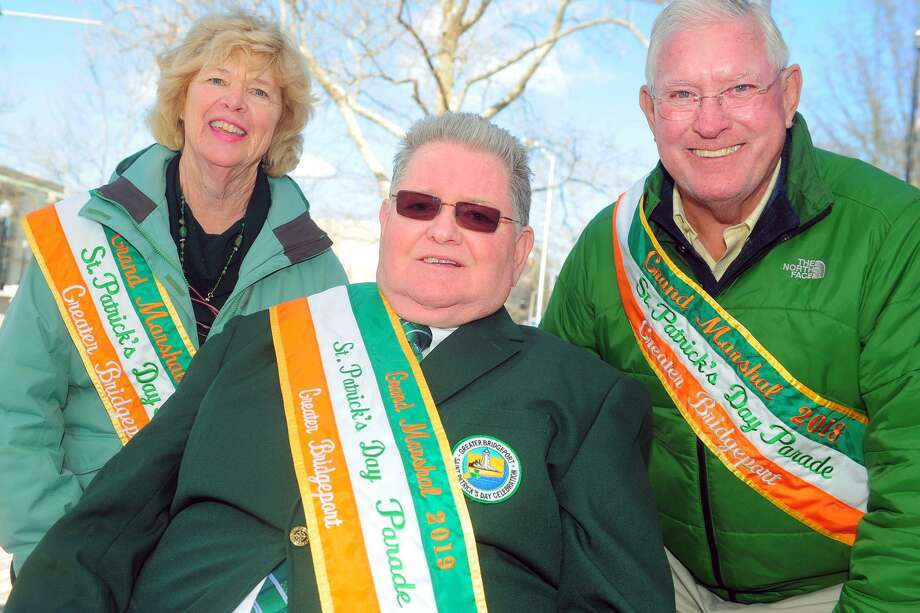Peter Carrol, center, Grand Marshall for the 2019 Greater Bridgeport Saint Patrick's Day Parade, poses with last year's Grand Marshalls, Ann Marie and Dave Curtin, in Bridgeport, Conn. March 11, 2019. The parade and other festivities take place in downtown Bridgeport his Friday. Photo: Ned Gerard / Hearst Connecticut Media / Connecticut Post