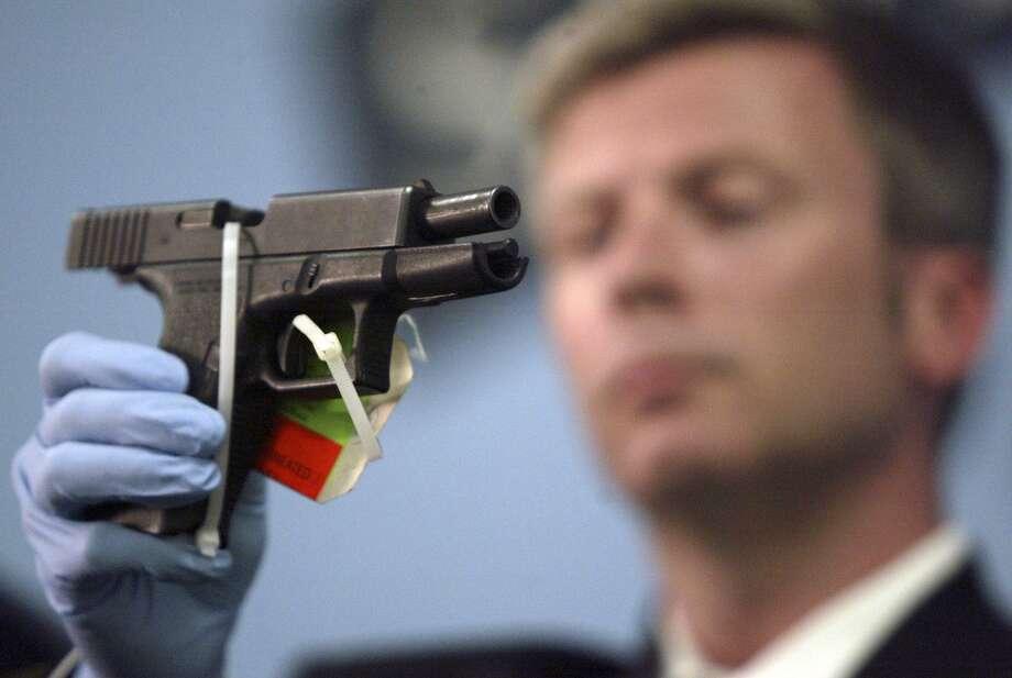 A Glock 9 mm Photo: JIM BRYANT / Seattle Post-Intelligencer / Seattle Post-Intelligencer