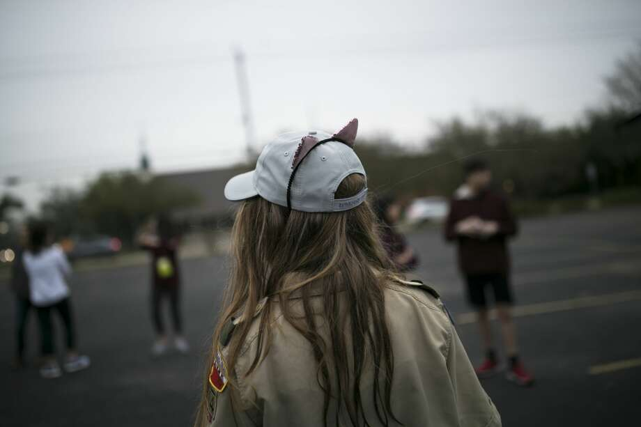 Izzy Thrash, 12, added cat ears to her Scouts BSA uniform as the group prepared to leave for their first Camporee. Photo: Marie D. De Jesús/Staff Photographer