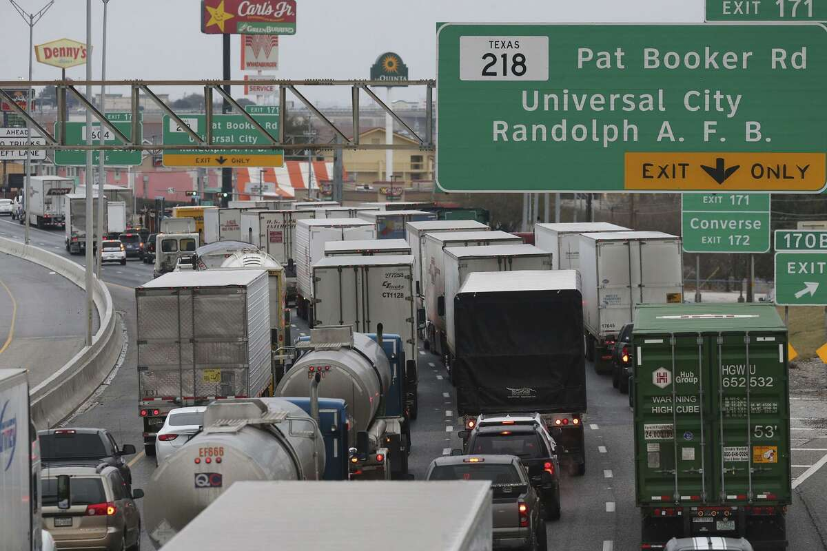 Traffic is diverted off Interstate 35 northbound at Pat Booker Road Tuesday January 16, 2018 because of dangerous and icy conditions in the San Antonio area.