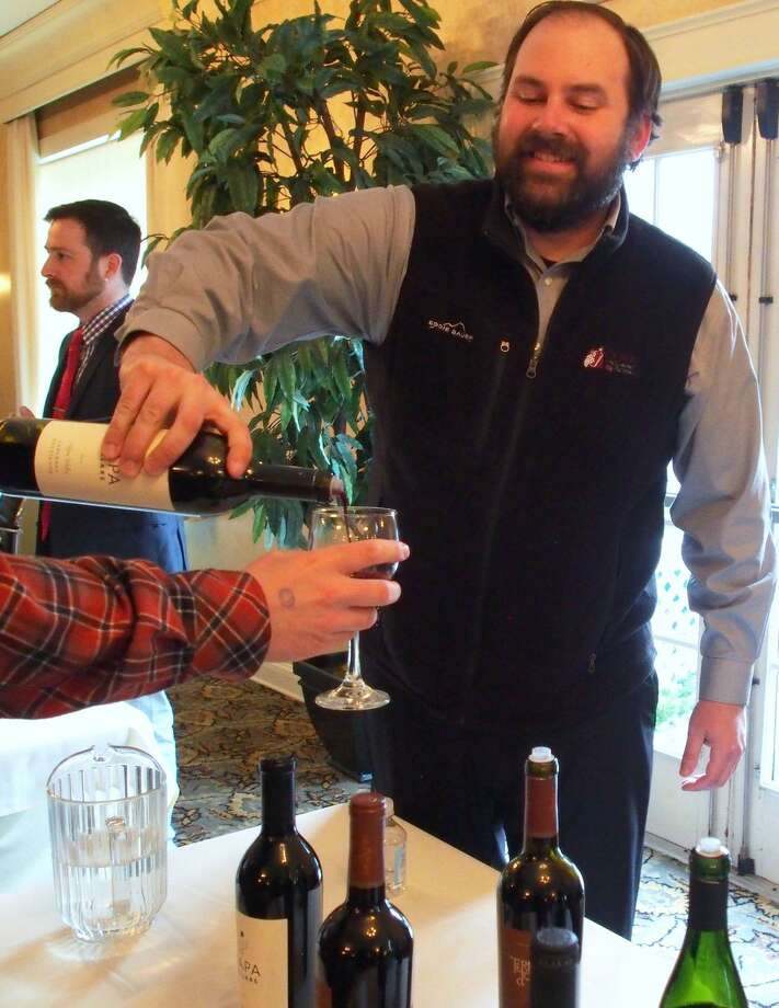 A wine steward serves a guest during the 2018 spring wine tasting to benefit LARC of Torrington. Photo: Contributed Photo