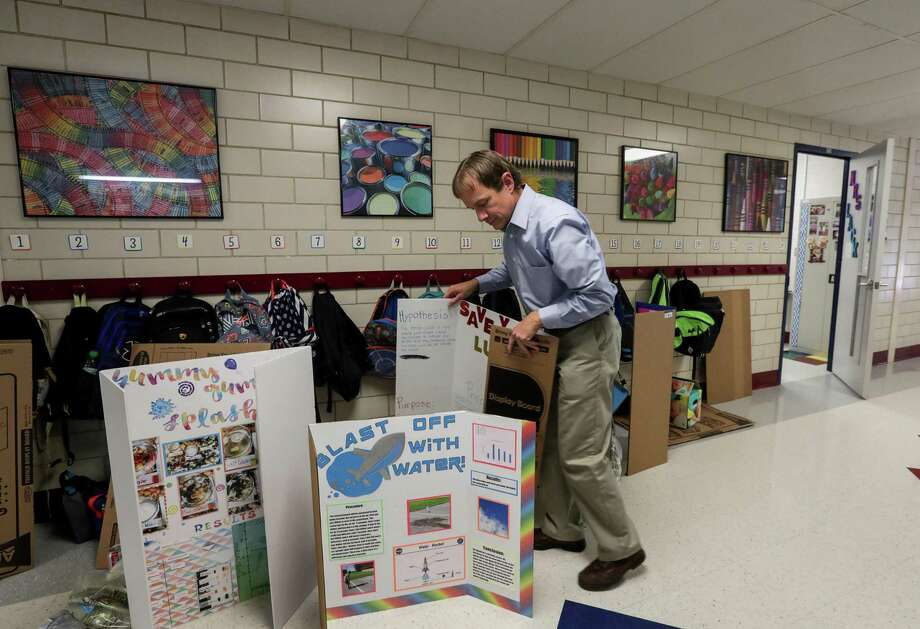 Steven Horelica, the mayor of Devers, Texas, and the fifth grade teacher at Devers Elementary School, arranges science projects outside of his classroom, Tuesday, May 8, 2018, in Devers. ( Jon Shapley / Houston Chronicle ) Photo: Jon Shapley, Houston Chronicle / Houston Chronicle / © 2018 Houston Chronicle