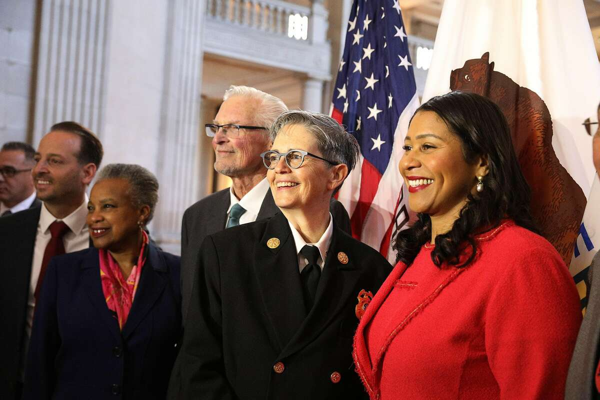 Deputy Chief Jeanine Nicholson (second from right) and Mayor London Breed (right) stand with others after a news conference where Mayor Breed announced Nicholson as the new San Francisco Fire Chief on Wednesday, March 13, 2019 in San Francisco, Calif.