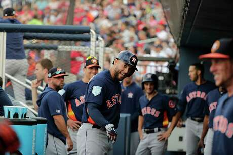 Houston Astros center fielder George Springer (4) in the dugout before an exhibition spring training baseball game Tuesday, March 12, 2019, in West Palm Beach, Fla. (AP Photo/Brynn Anderson)