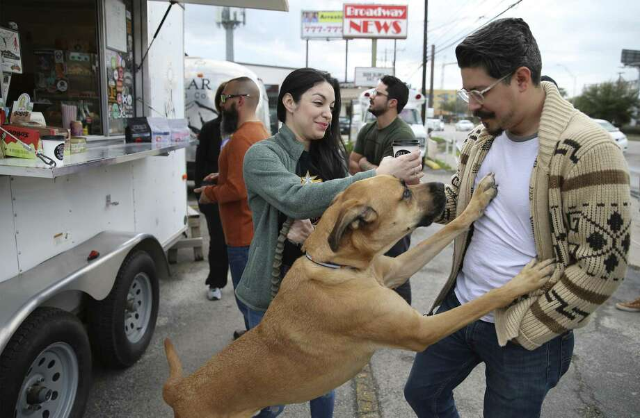 "Lynette Cano, Jomando Cruz and their Great Dane mix buy cappuccinos at Mila Coffee on Broadway. The coffee truck is surrounded by other ""micro-retailers"" that draw millennials, who as consumers tend to prefer experiences over things. Photo: Kin Man Hui / ©2019 San Antonio Express-News"