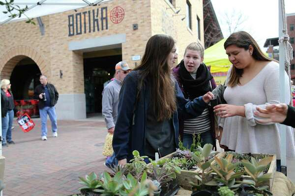 Lindsey Correa, from left, Kennedy Schoenaker and Bri Gomez shop at the farmers market at the Pearl in January. A recent study found millenials, who tend to trend liberal, are flocking to San Antonio. Could many millenials really be conservatives and just not know it?