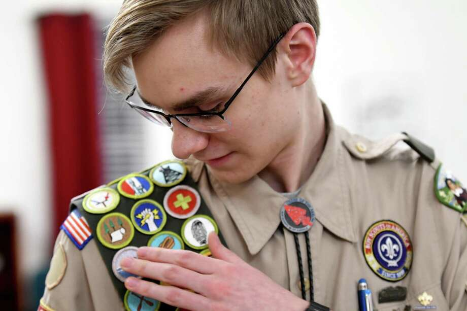 Eagle Scout Erick Christian of Delmar looks over the starting point of his sash displaying all 138 Boy Scouts of America merit badges on Wednesday, March 6, 2019, in Delmar, N.Y. Only 405 Boy Scouts have achieved this since the organization was founded in 1910. (Will Waldron/Times Union) Photo: Will Waldron, Albany Times Union / 40046338A