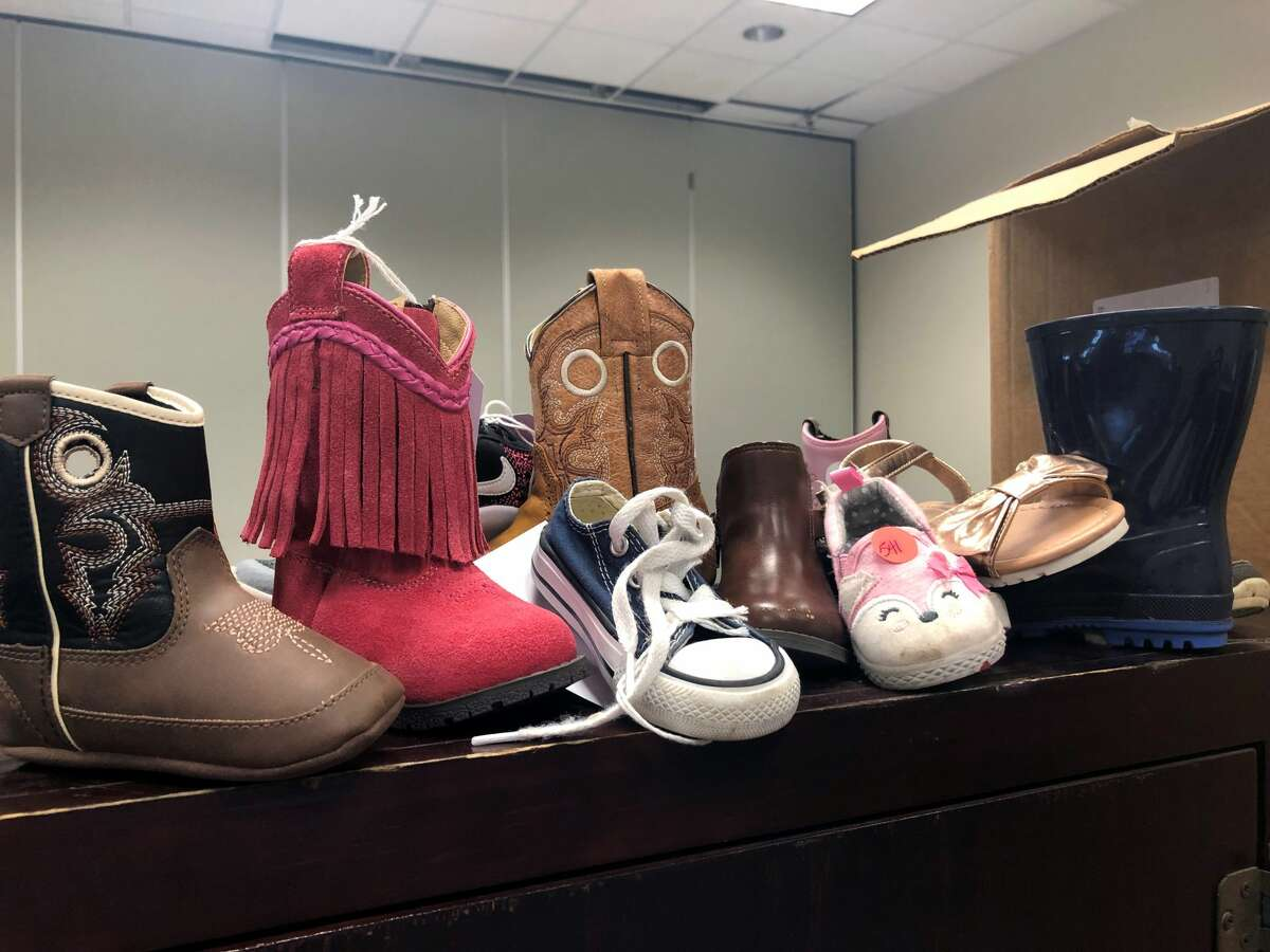 Kids' shoes, usually one and not a pair, are waiting to be claimed at the lost and found.