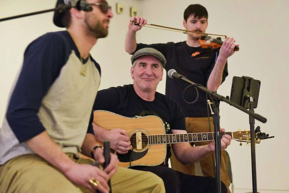 Members of the band Kilashandra, Christian Frese, left, Chris Gil, center, and Greg Engel perform at the St. Patrick's Day Celebration on the concourse level of the Empire State Plaza on Wednesday, March 13, 2019, in Albany, N.Y.  (Paul Buckowski/Times Union) Photo: Paul Buckowski, Albany Times Union / (Paul Buckowski/Times Union)