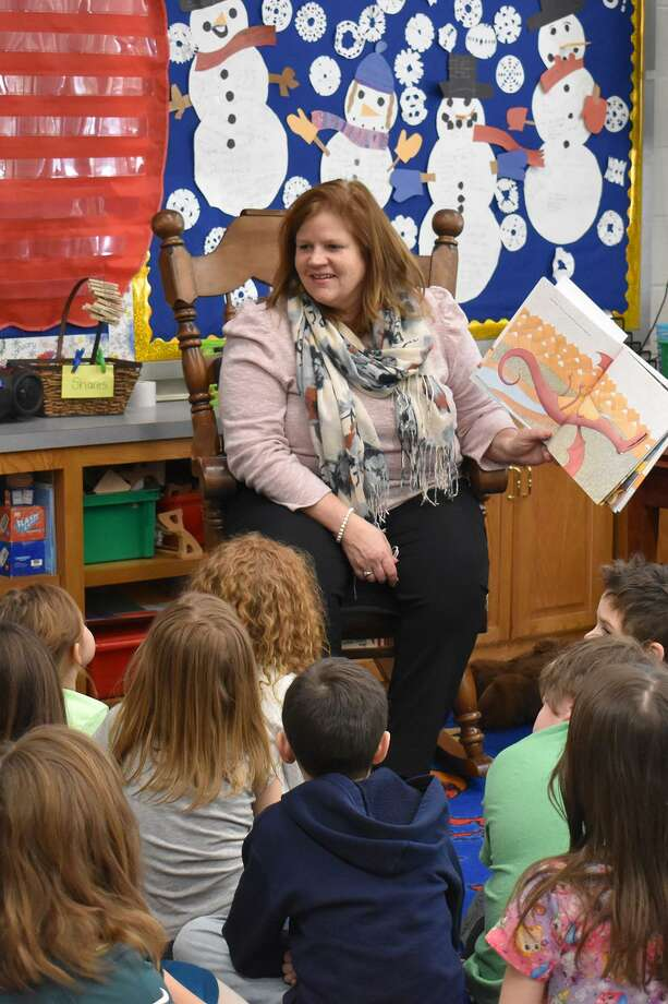 "State Rep. Irene Haines, R-East Haddam, celebrates Read Across America Day March 1 by reading ""Dragons Love Tacos"" by Adam Rubin to grade-schoolers at East Haddam Elementary School. Photo: Contributed Photo"