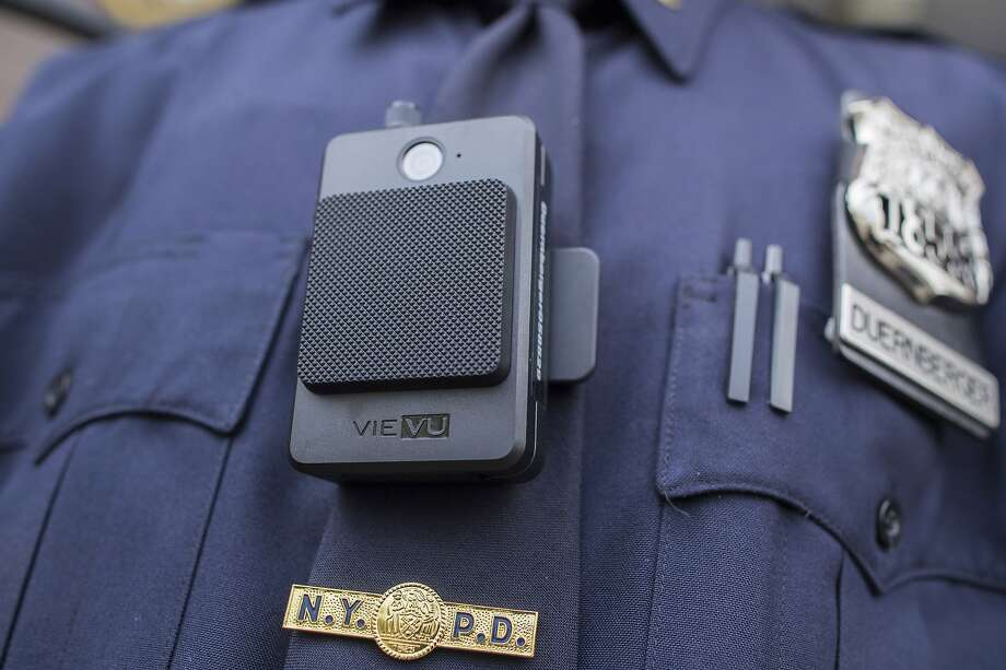 A N.Y. officer wears a newly-issued body camera in 2017. Most law enforcement agencies and prosecutors cite exemptions that allow them to keep records of pending investigations secret. Photo: Mary Altaffer / Associated Press 2017
