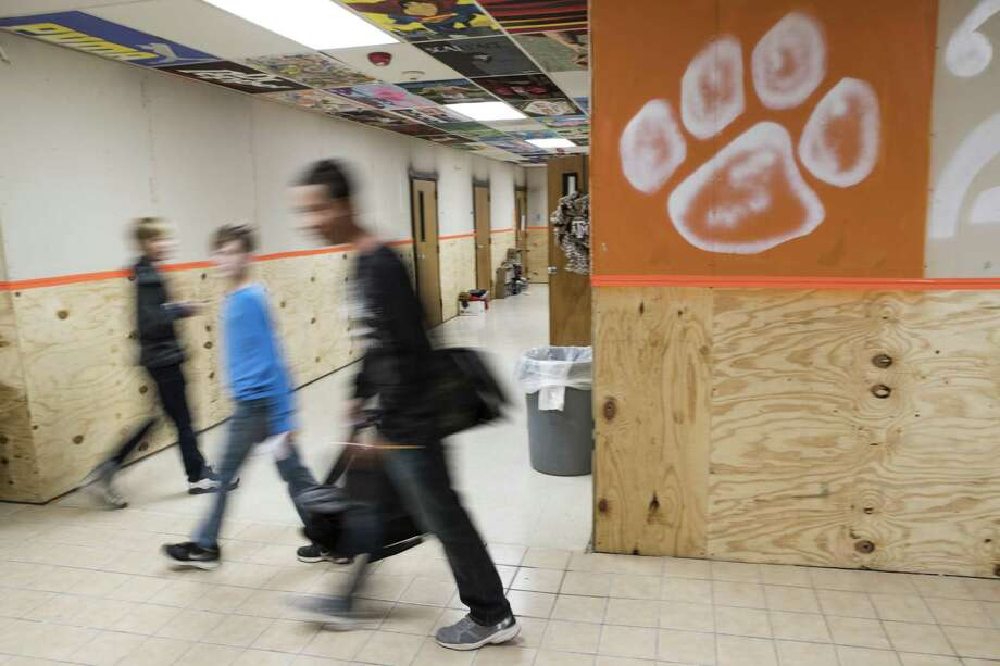 Orangfield ISD students walk through the halls of a flood damaged school on Monday, Dec. 11, 2017, in Orangefield, Texas. ( Brett Coomer / Houston Chronicle ) Photo: Brett Coomer, Staff / Houston Chronicle / © 2017 Houston Chronicle