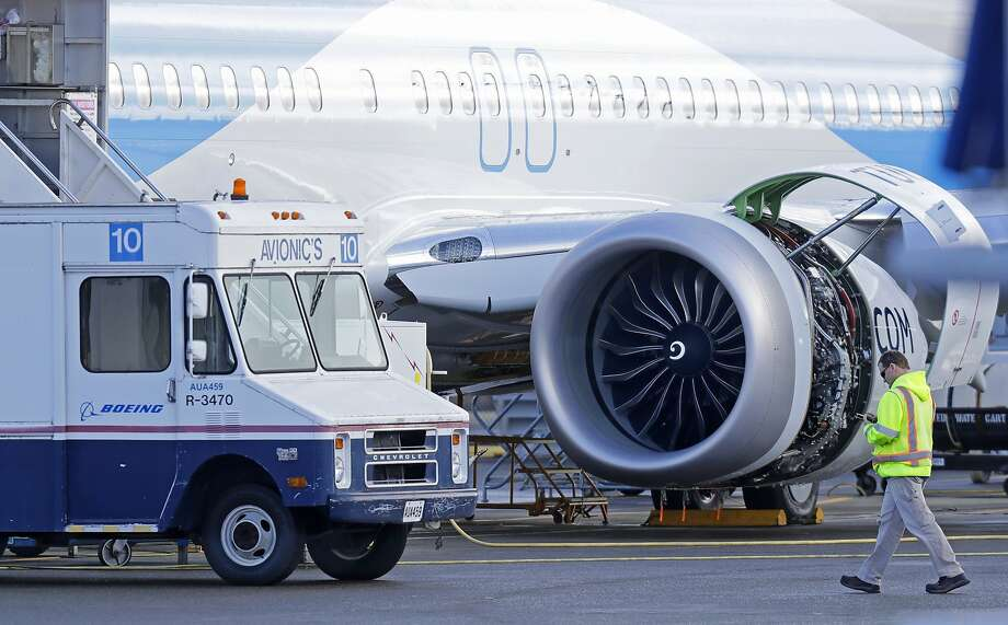 A worker walks toward an avionics truck parked next to a Boeing 737 MAX 8 airplane being built for TUI Group at Boeing Co.'s Renton Assembly Plant Wednesday, March 13, 2019, in Renton, Wash. (AP Photo/Ted S. Warren) Photo: Ted S. Warren, Associated Press