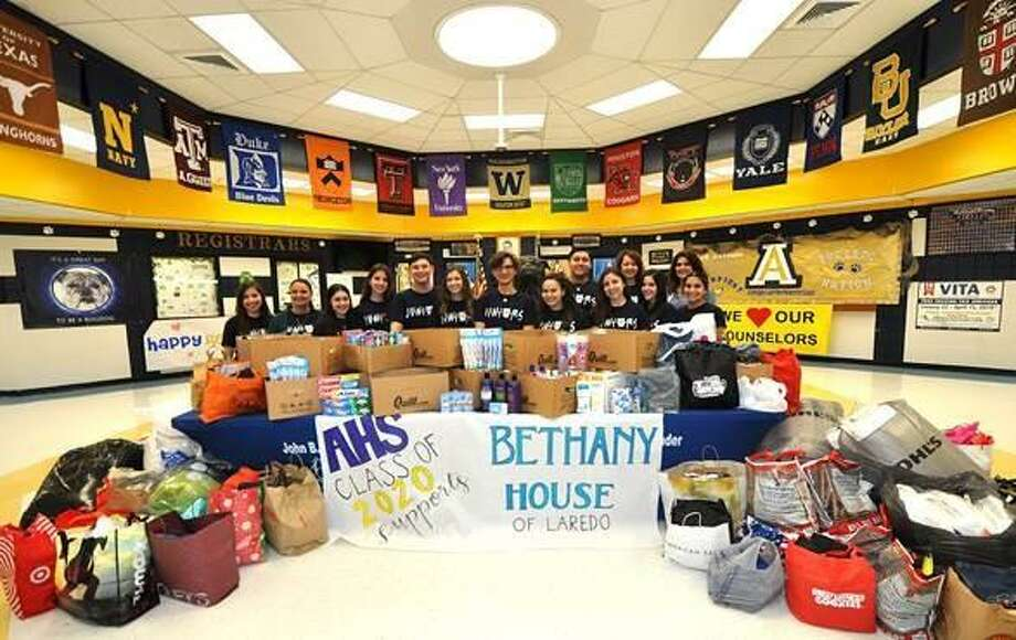 Shown are students from the Alexander High School Class of 2020 with several articles of clothing, personal care products and bedding for donation to the Bethany House of Laredo. Photo: Courtesy Photo