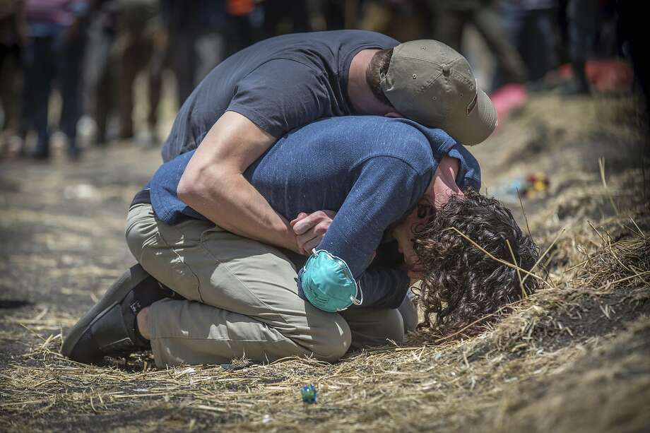Relatives of victims mourn at the crash site of Ethiopian Airlines south of Addis Ababa. DNA work for identifications of the remains has not yet begun. The dead came from 35 countries. Photo: Mulugeta Ayene / Associated Press