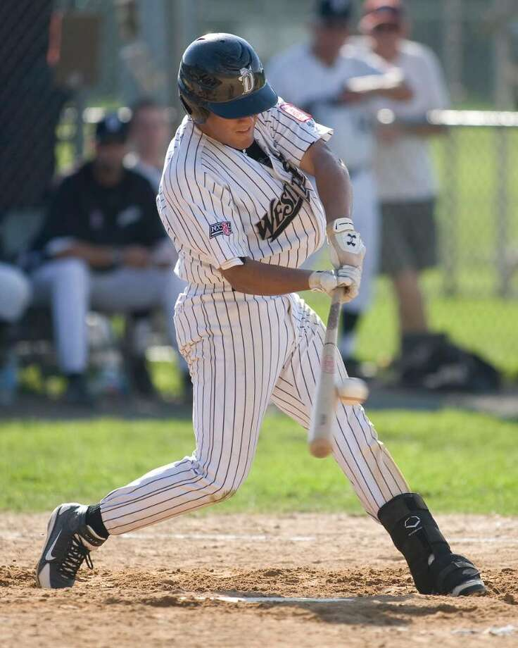 The Westerners' Alfredo Rodriguez makes contact against Holyoke Saturday at Rogers Park. Photo: Barry Horn / The News-Times Freelance