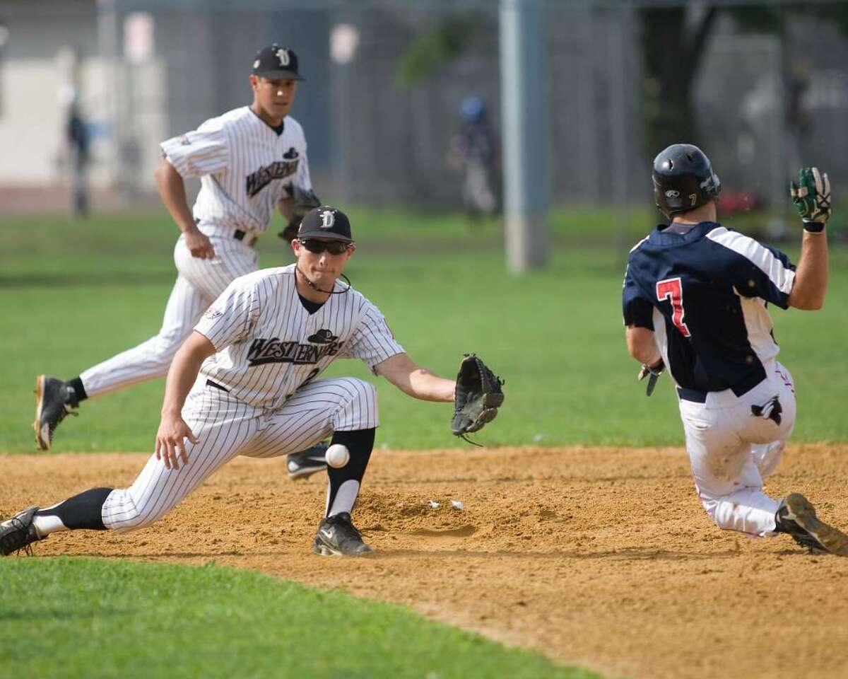 The Westerners' Tucker Nathans reaches for a wide throw as Holyoke's Sam Bean steals second base Saturday at Rogers Park.