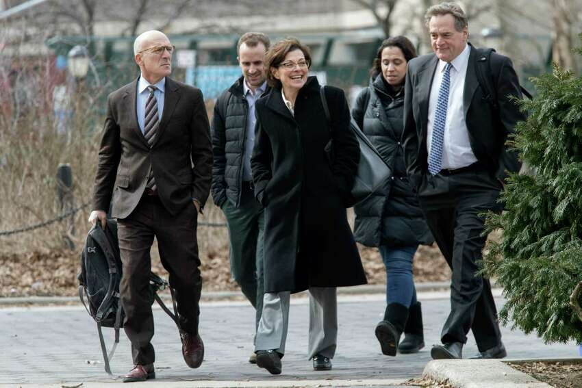 Nancy Salzman, center, arrives at Brooklyn federal court, Wednesday, March 13, 2019, in New York. Salzman, a co-founder of NXIVM, an embattled upstate New York self-help organization, is expected to plead guilty in a case featuring sensational claims that some followers became branded sex slaves.