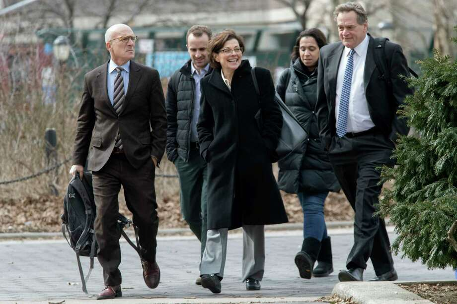 Nancy Salzman, center, arrives at Brooklyn federal court, Wednesday, March 13, 2019, in New York. Salzman, a co-founder of NXIVM, an embattled upstate New York self-help organization, is expected to plead guilty in a case featuring sensational claims that some followers became branded sex slaves. Photo: Mary Altaffer, AP / Copyright 2019 The Associated Press. All rights reserved.