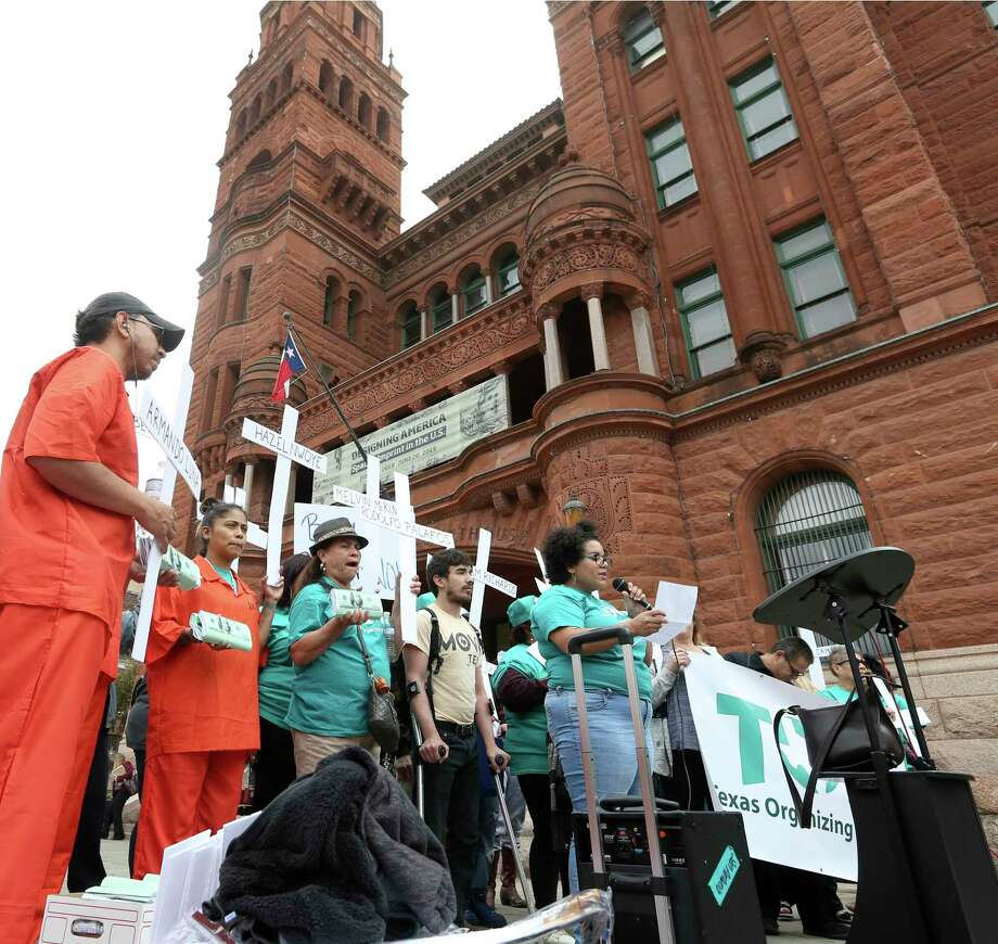 Members of the Texas Organizing Project hold a press conference March 7 outside the Bexar County courthouse. They are asking Bexar County judges to create a concrete plan to end the practice of cash bail in the county. Such a practice might have prevented the death in jail of Jack Michael Ule in April. Photo: William Luther /San Antonio Express-News / © 2019 San Antonio Express-News