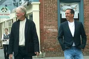 "David Letterman and Jerry Seinfeld saunter along Bank Street during the veteran comics' stop in New Milford to film a spot for Seinfeld's show, ""Comedians In Cars Getting Coffee."" Courtesy of Cynthia O'Connor"