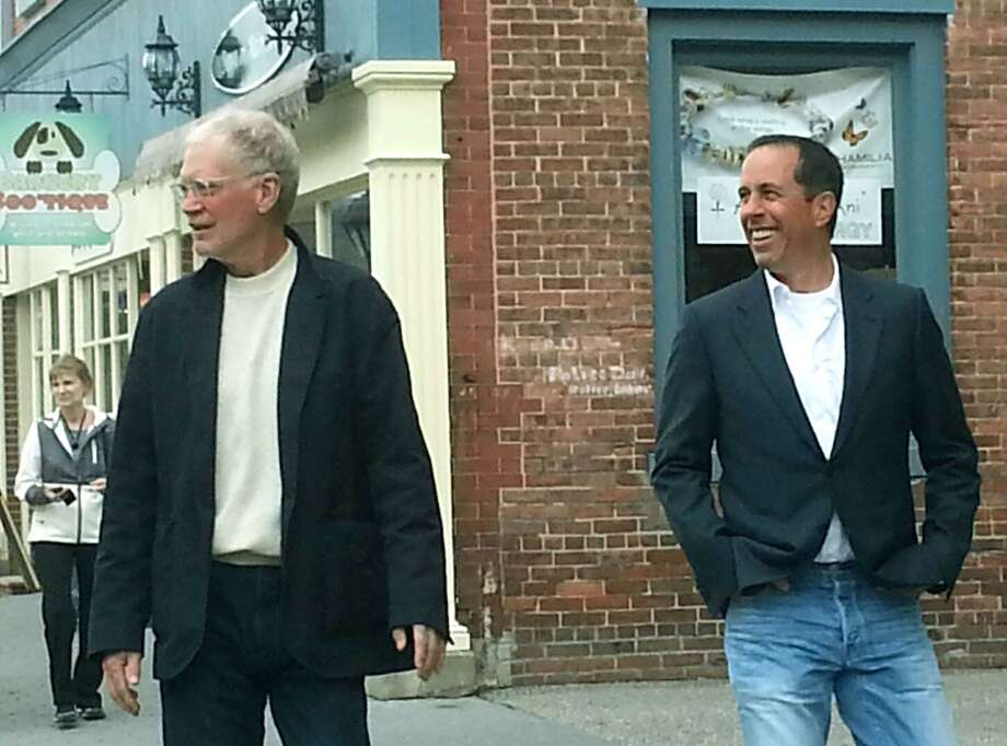 """David Letterman and Jerry Seinfeld saunter along Bank Street during the veteran comics' stop in New Milford to film a spot for Seinfeld's show, """"Comedians In Cars Getting Coffee."""" Courtesy of Cynthia O'Connor Photo: Contributed Photo / Contributed Photo / The News-Times Contributed"""
